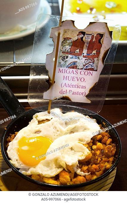 'Migas' with egg in Taberna de Baco, Calle Laurel area, Logroño, La Rioja, Spain