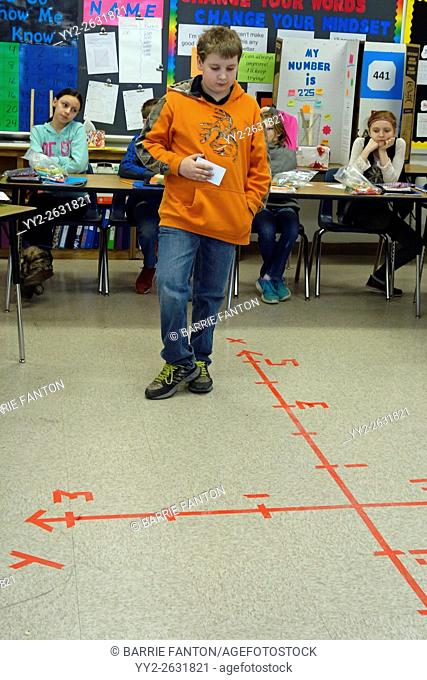 6th Grade Boy Solving Math Coordinates Problem, Wellsville, New York, USA
