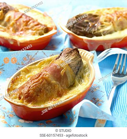 Red chicory,raw ham and Ossau iraty cheese-topped dish