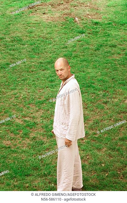 Man in his pijamas on the grass