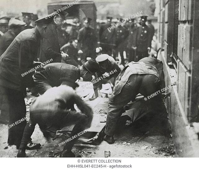 Police removing rubble to reach bodies after the Wall St. Bombing, Sept. 16, 1920, New York City. (BSLOC-2015-17-239)