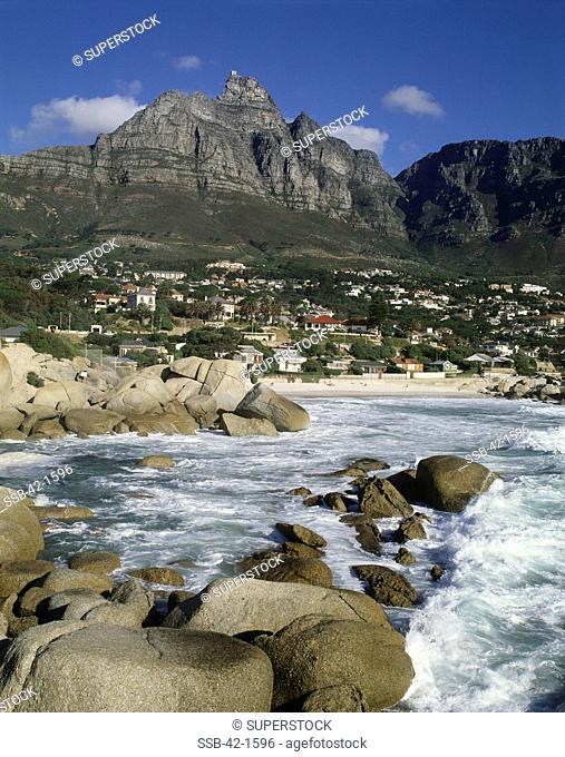 River flowing near a town with mountains in the background, Camps Bay, Cape Town, South Africa