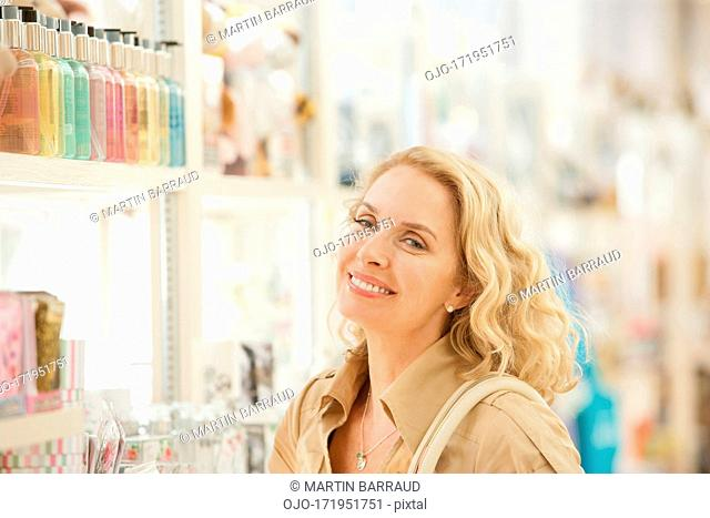 Smiling woman in store