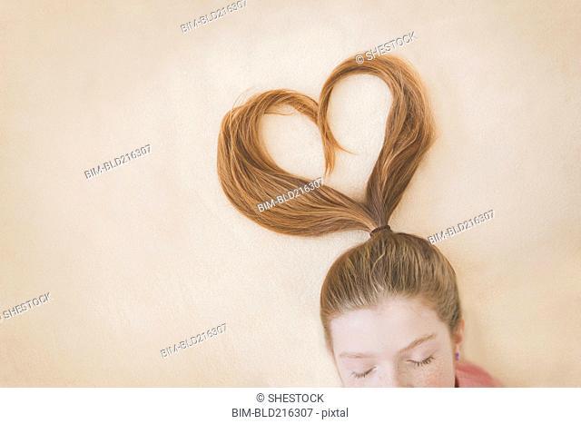 Ponytail of Caucasian girl in heart shape