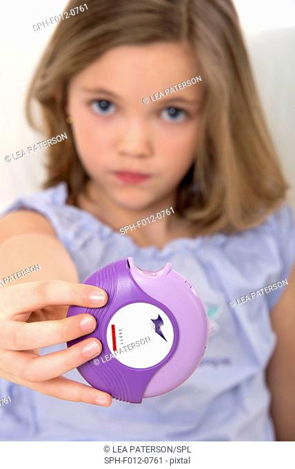 Girl holding asthma medication
