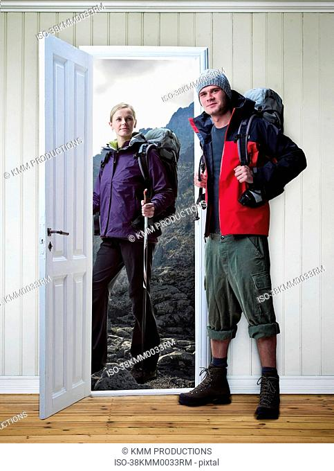 Hikers standing in new house
