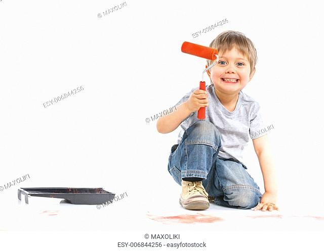 happy young boy painting. Isolated over white background