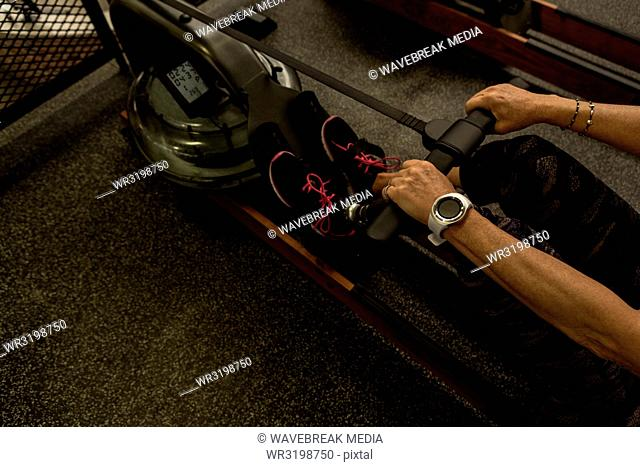 Woman exercising on a machine in the gym