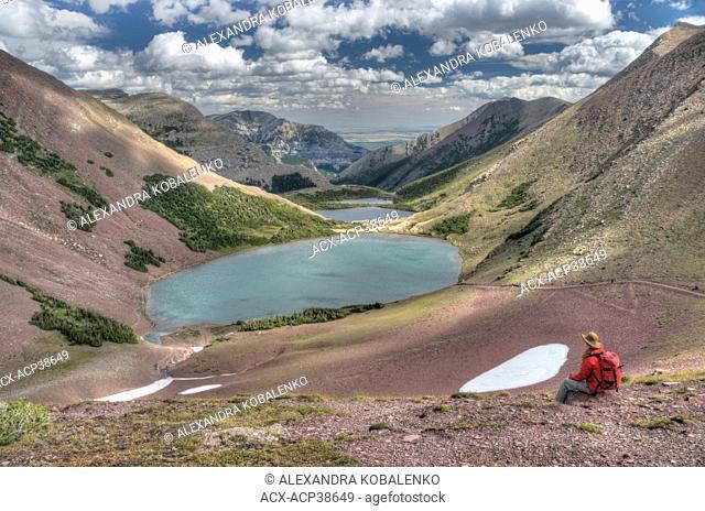 Female hiker viewing Carthew Lakes from Carthew-Alderson Trail, Waterton Lakes National Park, Alberta, Canada