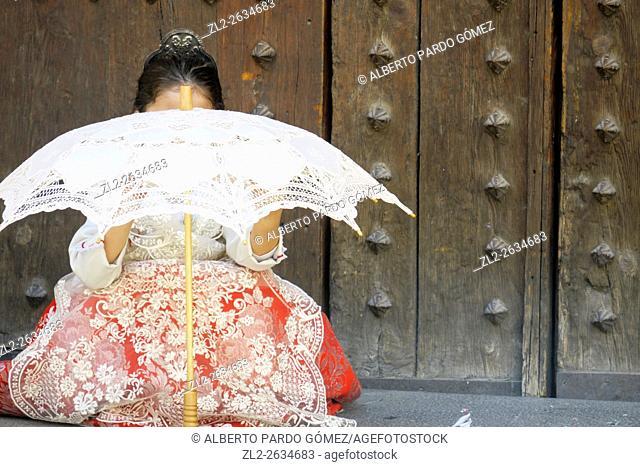 Fallera child with umbrella, valencia, Spain