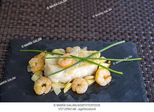 Hake loin with prawns, spring onion and garlic
