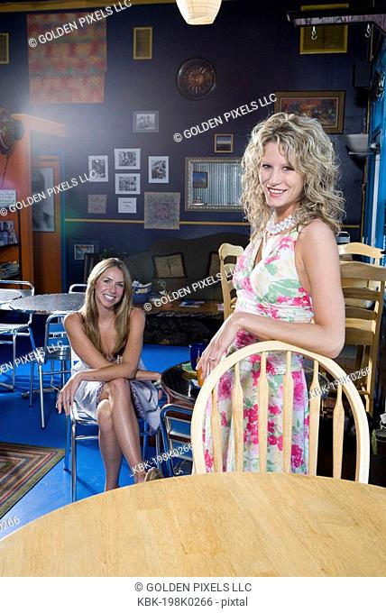 Pretty young women in a cafi