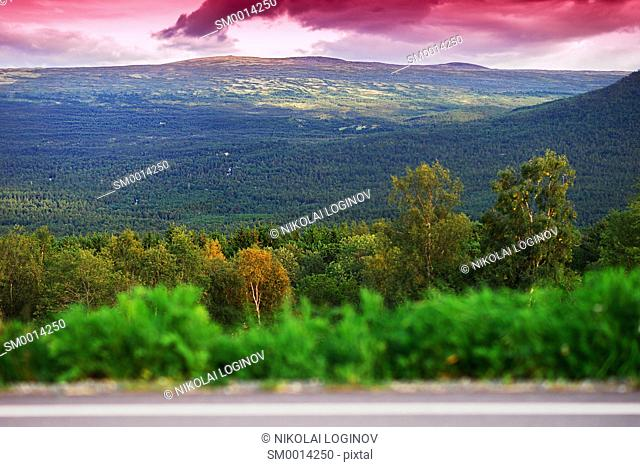 Norway mountain transportion road with bokeh and pink sunset background hd