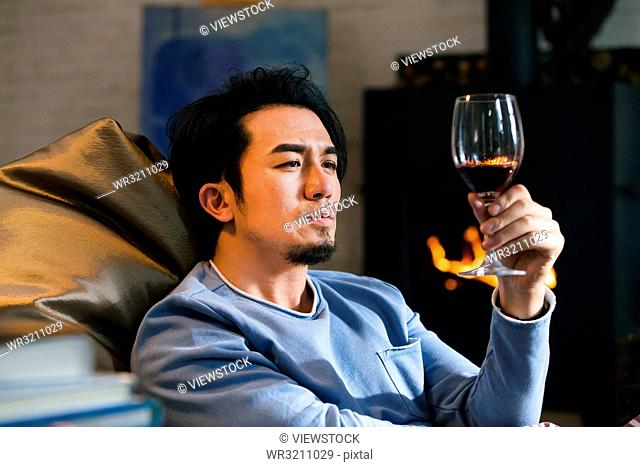 Male artist in the drink red wine
