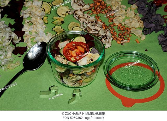 filling dried vegetables in a glass