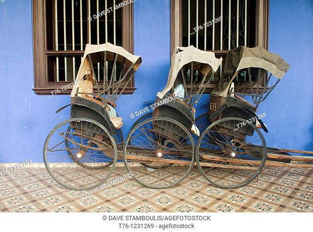 bicycle rickshaws in front of the Cheong Fatt Tze Chinese Mansion in Georgetown, Malaysia