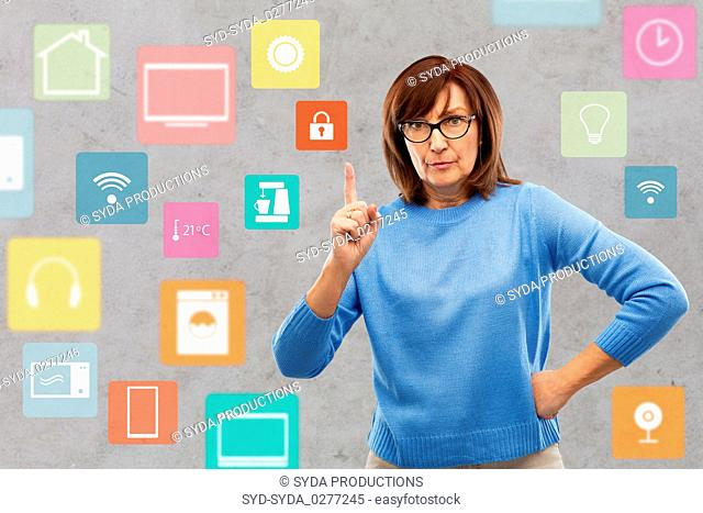 worried senior woman pointing to lock icon