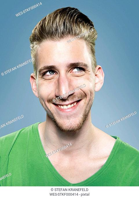 Portrait of smiling young man, studio shot