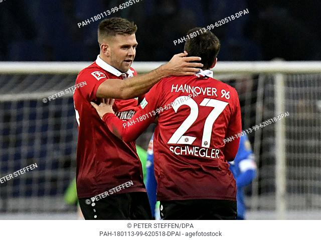 Hannover's Niclas Fuellkrug celebrates after his goal for 1:2 with Pirmin Schwegler (r) during the German Bundesliga football match between Hannover 96 and FSV...