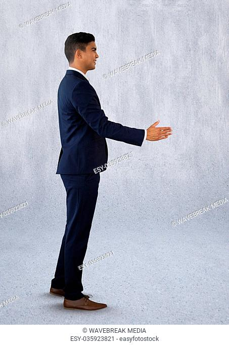 Businessman reaching out for handshake
