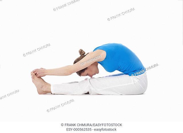 woman exercising hatha yoga - isolated on white