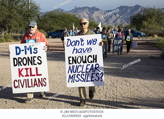 Tucson, Arizona - Peace activists gather at the entrance to Davis-Monthan Air Force Base, protesting war, drones, and nuclear weapons