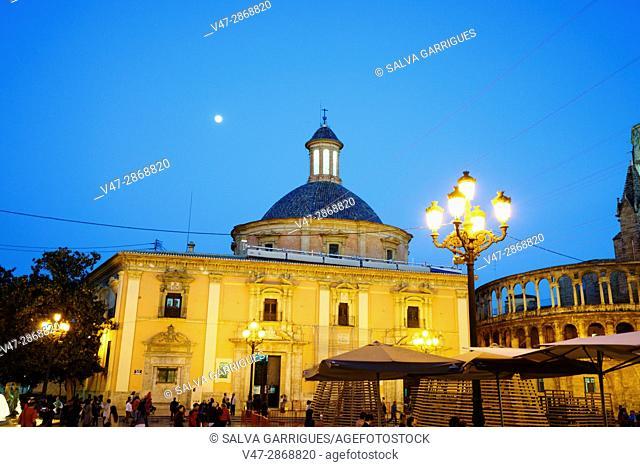 Facade of the Basilica of the Virgin of the Desamparados at dusk with full moon, Plaza de la Virgen, Valencia, Spain
