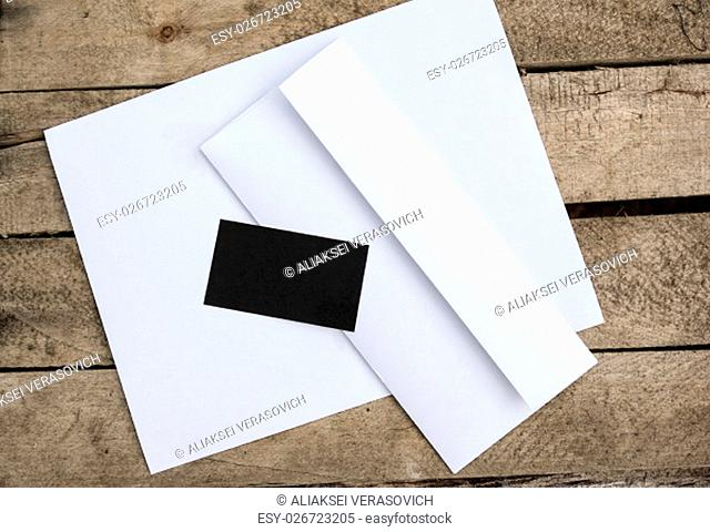 Blank stationery and corporate identity template on wooden background. For design presentations and portfolios
