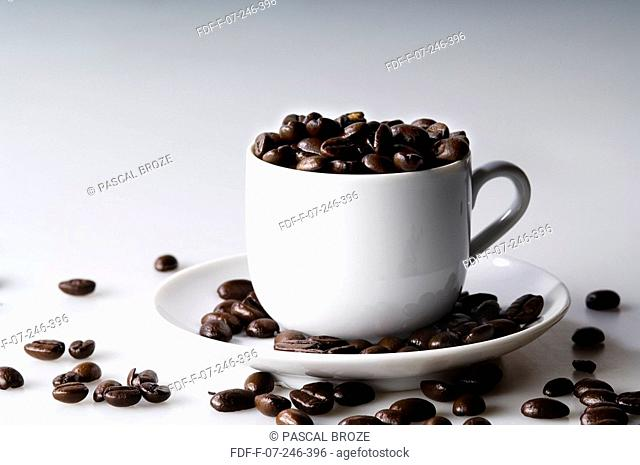 Close-up of coffee beans in a cup