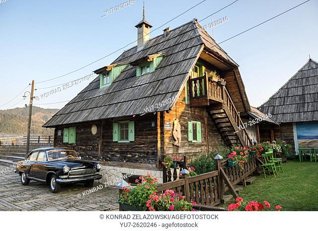 GAZ M21 Volga car (Third Series) in front of Main House of Drvengrad village (Kustendorf) built by Emir Kusturica, Serbia