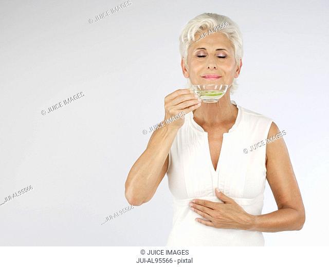 Senior woman with tea, portrait