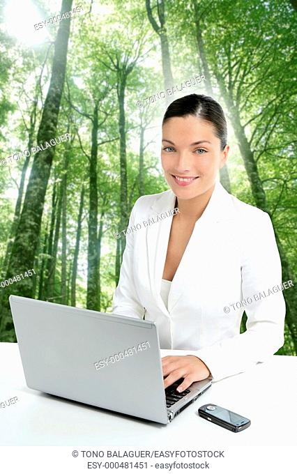 Beautiful headset operator woman in an ecological forest green background