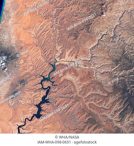 Lake Powell, is a reservoir on the Colorado River, straddling the border between Utah and Arizona (most of it, along with Rainbow Bridge, is in Utah)