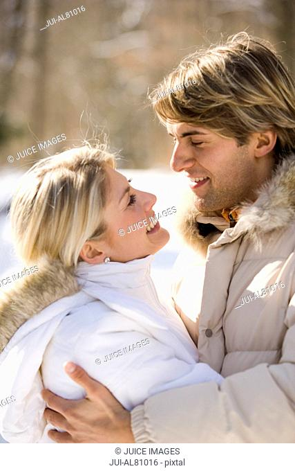 Couple hugging outdoors in winter