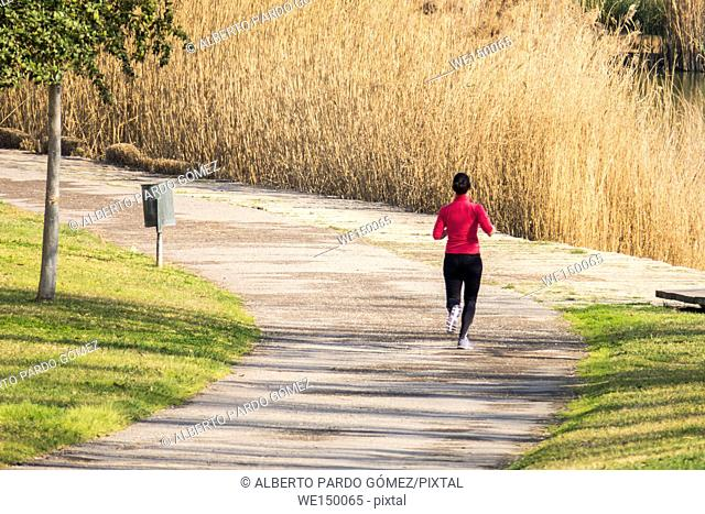 Woman running in the park, Valencia