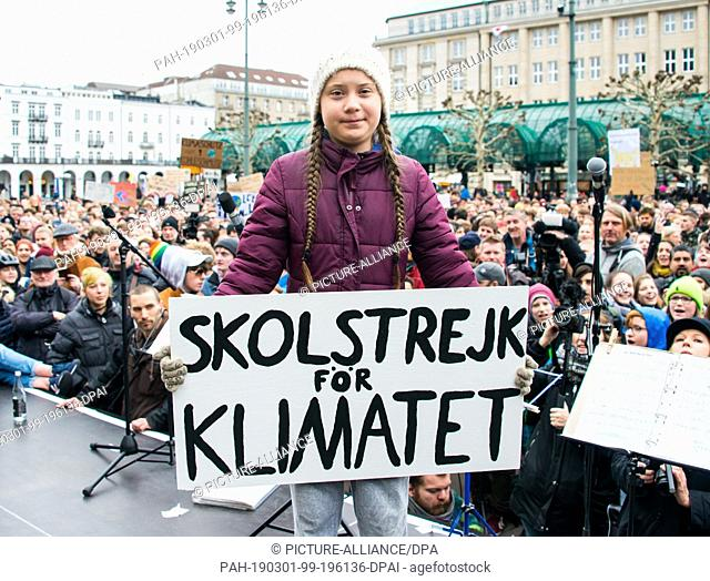 01 March 2019, Hamburg: Greta Thunberg, climate activist, stands on a stage during a rally at the town hall market. The young Swedish woman has come to Germany...
