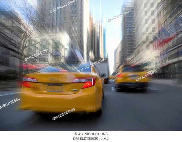 Blurred view of taxis driving on New York street, New York, United States