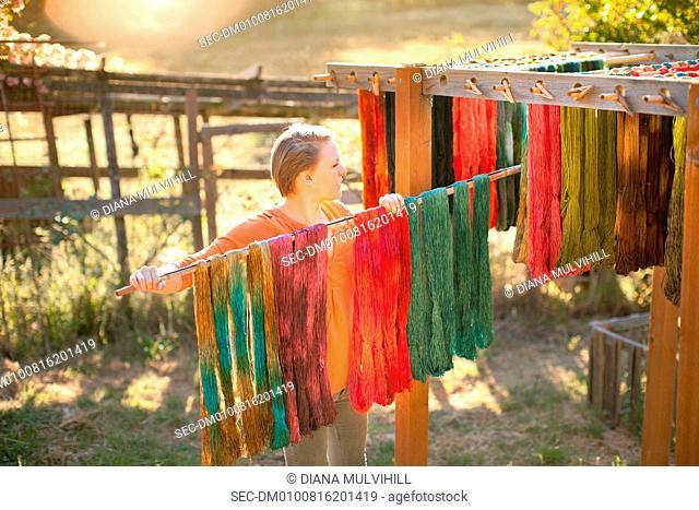 Woman hanging yarn for drying