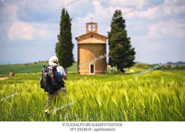 Europe, Italy photographer at the chapel Vitaleta, province of Siena, Tuscany