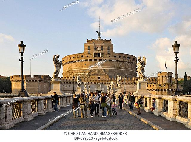 Group of tourists on Ponte Sant' Angelo bridge with Sant' Angelo Castle before sunset, Rome, Italy, Europe