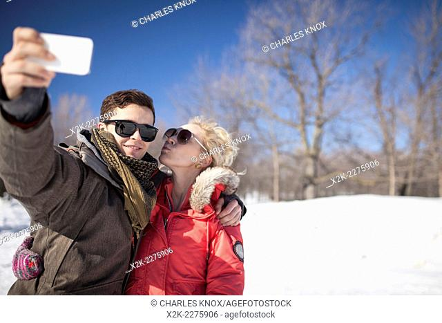 Attractive couple taking a selfie while ice skating