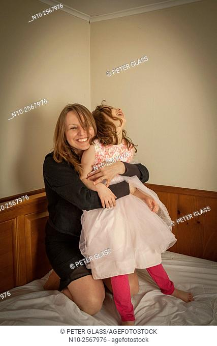 Mother playing with her six year old daughter