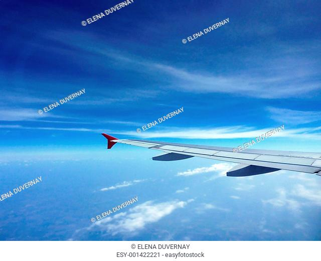 Wing of a plane flying in the sky