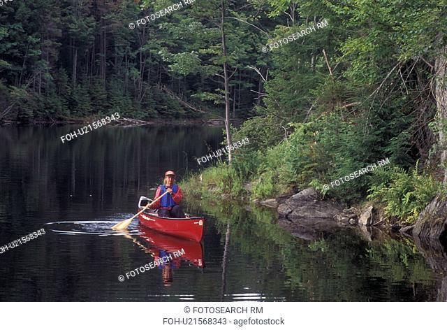 canoeing, canoe, Vermont, VT, Woman paddling a red canoe on Green River Reservoir in Hyde Park