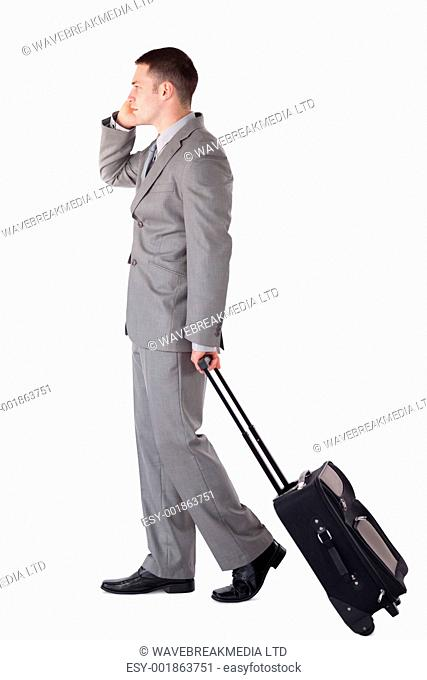 Portrait of a handsome businessman on the go against a white background