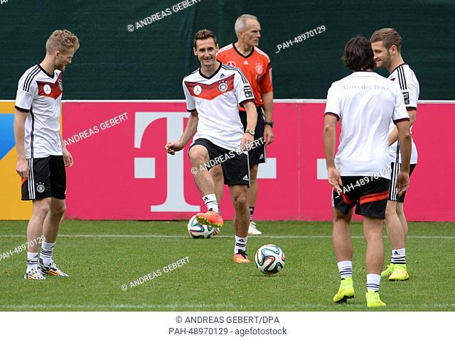Andre Schuerrle (L-R), Miroslav Klose, Sami Khedira and Shkodran Mustafi of the German national soccer team attend a training session on a training ground at St