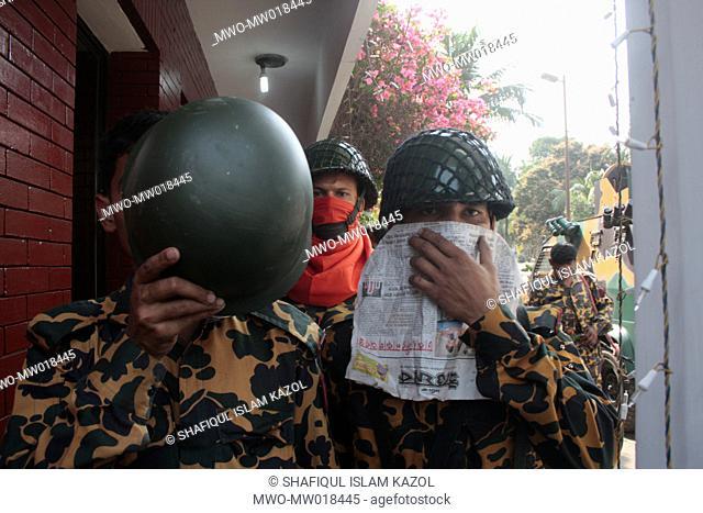 The rebel BDR men at the main gate of BDR Headquarters, in Pilkhana, Dhaka, Bangladesh A mutiny by Bangladesh Rifles, BDR