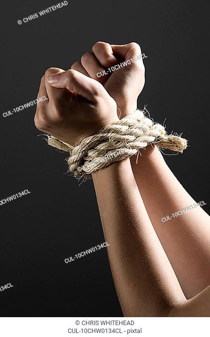 Female hands tied together