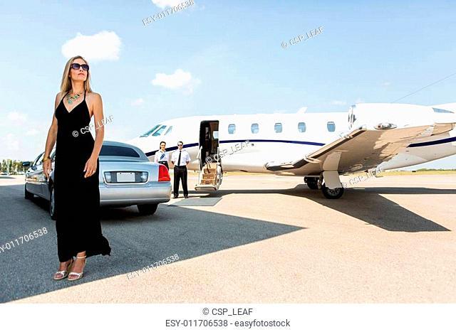 Rich Woman In Elegant Dress At Airport Terminal