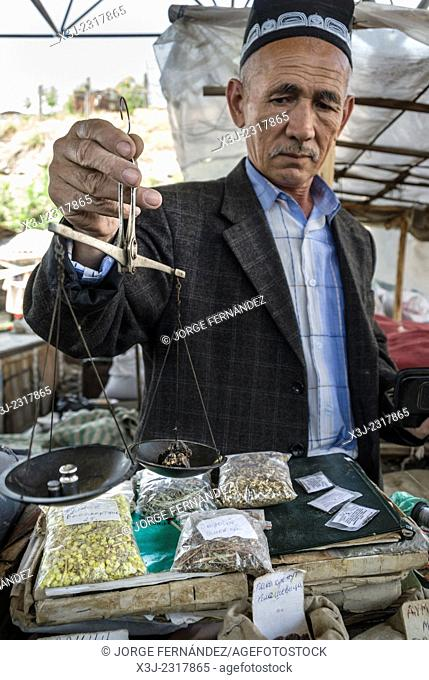 Man with a manual scale in the market of Osh, Kyrgyzstan